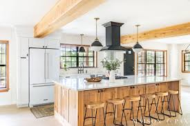 white kitchen cabinets with window trim black windows and other window trends maison de pax