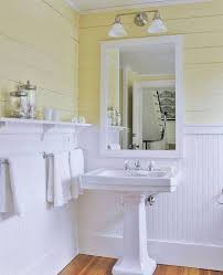 beadboard wainscoting in bathroom with yellow plank walls and