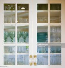Glass For Kitchen Cabinet Glasses And Bowls In Kitchen Cabinet View Through Glass Doors