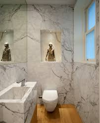 statuary marble for a contemporary powder room with a marble