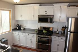Rustoleum Paint For Kitchen Cabinets Thrifty Remodeling Before And After Rustoleum White Cabinets