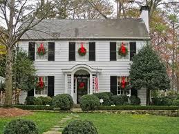 window wreaths wreaths hanging by a ribbon on each window decor