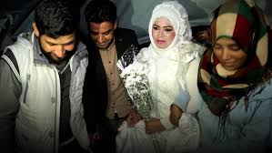 syrian refugees with donated wedding dress news