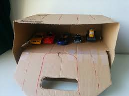 ikea hack for kids turn box into toy car parking garage