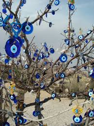 nazar boncuk amulet tree in capadocia by colin looker evil eye