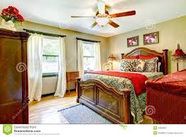 elegant bedroom with red and gold interior royalty free stock