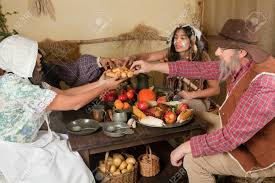 images of a thanksgiving dinner reenactment scene of the first thanksgiving dinner in plymouth