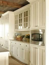 cream kitchen cabinets to ceiling kitchen