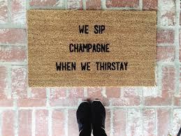 we sip champagne when we thirstay doormat outdoor mat home