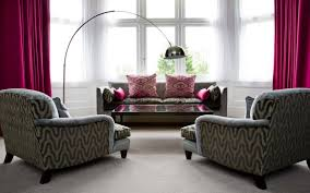 arc floor lamp in modern living room with grey sofa and chairs