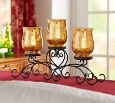 iron scroll centerpiece w 3 mercury glass lit hurricanes by