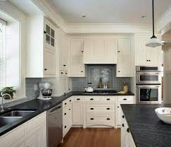 white kitchen cabinets with black countertops 5 modern white kitchen cabinet with black countertop ideas