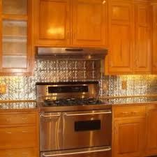 Punched Tin Backsplash With Oak Stained Cabinets Mom Country - Punched tin backsplash