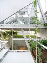 tilted glass homes slanted house