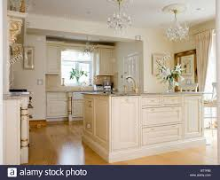 cream island unit in large cream country kitchen extension with