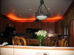 Ideas For Decorating The Top Of Kitchen Cabinets above cabinet lighting