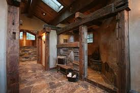 rustic master bathroom with skylight by high camp home zillow