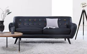 mid century modern tufted bonded leather sofa in color black with