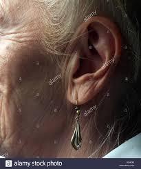 ear sense earrings woman shell ear stock photos woman shell ear stock images alamy