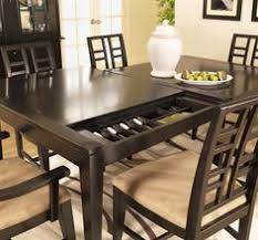 Secret Compartment In Antique Table Secret And Secure Spaces - Dining room table with hidden chairs