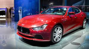 red maserati maserati confirms levante updates ghibli and quattroporte for
