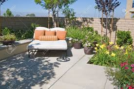 backyard oasis and suburban retreat with flowers lounge chair