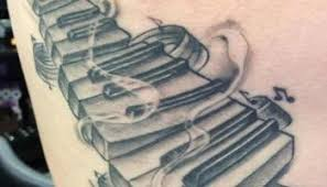 brilliant 3d piano tattoo made by grey ink