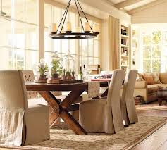 dining room centerpieces for tables round iron candle chandelier over rustic wood cross legs dining