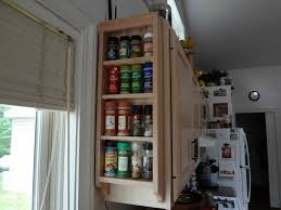 traditional kitchen design with wall mounted solid wood spice rack