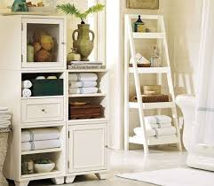 white stained oak wood standing bathroom linen cabinet storage
