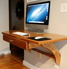 rectangle brown wooden floating imac computer desk with drawer on