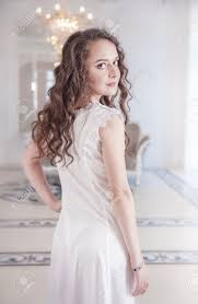 beautiful young woman in old fashioned negligee indoor stock photo