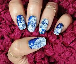 Nail Art Lace Design Stamped White Lace Over Holographic Blue Glitter Nail Art Design