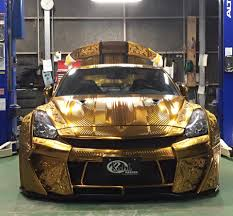 nissan 370z custom paint jobs gold nissan gt r with metal engraving has matching gold engine in
