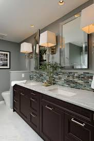 best 25 bathroom mirrors with lights ideas on pinterest this gray contemporary bathroom features a double vanity design with a carrera marble countertop glass tile backsplash and polished chrome sconces and