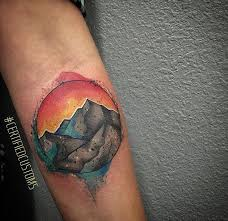 custom watercolor mountain scene tattoo done by chris roberts at