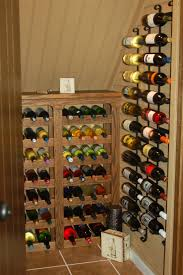 walk in closet equipped with staircase shelves for wine bottles
