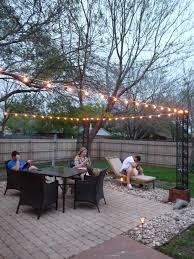 Outdoor Hanging Patio Lights by The Happy Homebodies Diy Stringing Patio Cafe Lights