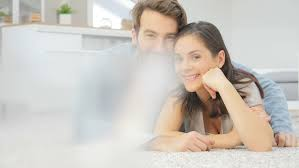 Carpet In Living Room by Couple Laying On Carpet In Living Room Stock Footage Video