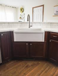 how to install farmhouse sink in base cabinet fireclay farmhouse kitchen sink installation guide