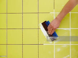 man grouting ceramic green bathroom tiles with tile ceramic no