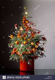 christmas tree decorated with natural decorations of corn stars