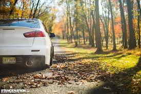 cars mitsubishi lancer white car mitsubishi lancer evo x in the park wallpapers and