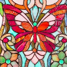 river of goods butterfly fleurs style stained glass window