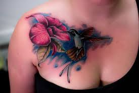 colored hummingbird on chest