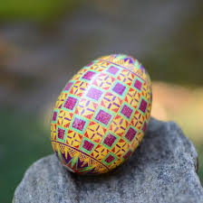 egg decorating supplies bright pysanka in golden and purple ukrainian easter eggs and