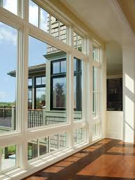 interior design wooden framed floor to ceiling windows with