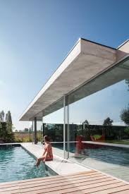 pool house glass and concrete pool house in belgium