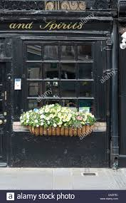outside pub window stock photos outside pub window stock images flowers growing in a window box basket outside a uk pub stock image