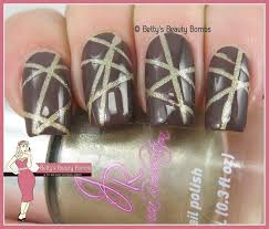 brown and gold striping tape nail art lazy betty